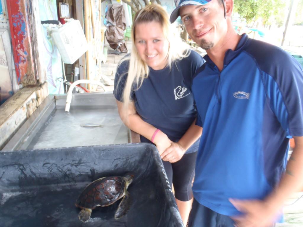 Rescuers Kiri and T.J. with 'Kiri', the turtle